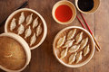 Homemade dim sum asian dumplings on a traditional bamboo steamer Royalty Free Stock Photo