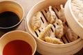 Homemade dim sum asian dumplings on a traditional bamboo steamer Stock Photography