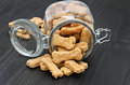 Homemade dog bones spilling from a glass jar. Royalty Free Stock Photo