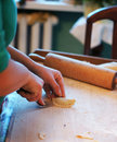 Homemade dumplings woman making in the kitchen Royalty Free Stock Photos