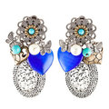 Homemade earrings with blue heart shaped stones Stock Image