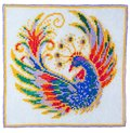 Homemade embroidery depicting the fabulous bird on white background Stock Images
