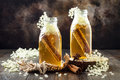Homemade fermented cinnamon and ginger kombucha tea infused with elderflower. Healthy natural probiotic flavored drink.