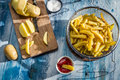 Homemade french fries made ​​from potatoes old wooden table Stock Photos