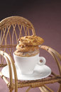 Homemade fresh cookies over coffee cup on a rocking chair studio shot of Royalty Free Stock Images