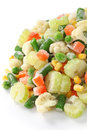 Homemade frozen vegetables on white background Royalty Free Stock Images