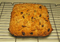 Homemade fruit cake heavy cake this is cornish cooling on wire stand Royalty Free Stock Images