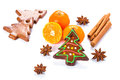 Homemade gingerbread in christmas tree shape with oranges and spices Royalty Free Stock Images