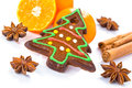 Homemade gingerbread in christmas tree shape with oranges and spices Stock Image