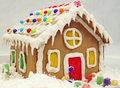 Homemade gingerbread house a traditional for christmas resting on snow Royalty Free Stock Images