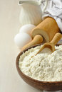 Homemade gluten free flour blend from rice millet potato starch and xanthan gum in wooden bowl met scoop Stock Image