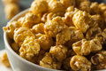 Homemade golden caramel popcorn in a bowl Royalty Free Stock Photography