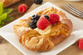 Homemade gourmet danish pastry with berries and icing Royalty Free Stock Photography