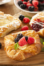 Homemade gourmet danish pastry with berries and icing Stock Photos