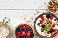 Homemade granola with greek yogurt, nuts and fresh berries in a bowl with cereal in ja Royalty Free Stock Photo
