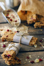 Homemade granola protein bars with peanut butter honey nuts and cranberries on a wooden board Stock Photography