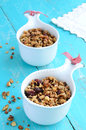 Homemade granola on wooden turquoise background with oatmeal dried cranberry almond walnut bright Royalty Free Stock Photos