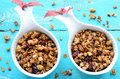 Homemade granola on wooden turquoise background with oatmeal dried cranberry almond walnut bright Royalty Free Stock Photography