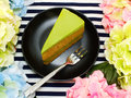 Homemade green tea cake on dish with spring flower and space copy background Royalty Free Stock Photo