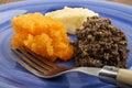 Homemade haggis with mashed potato and turnip
