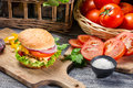 Homemade hamburger chicken fresh vegetables old wooden table Stock Photo
