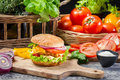 Homemade hamburger chicken vegetables old wooden table Royalty Free Stock Photography