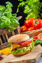 Homemade hamburger made fresh vegetables old wooden table Stock Photography