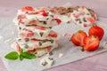 Homemade healthy frozen strawberry yogurt bark on rustic wooden Royalty Free Stock Photo