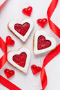 Homemade heart shaped cookies gift with jam and red ribbons for Royalty Free Stock Photo