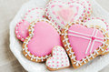Homemade heart shaped sugar cookies with icing on white plate Royalty Free Stock Photo