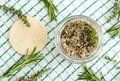 Homemade herbal scrub foot soak or bath salt with rosemary, thyme, sea salt and olive oil. Natural skin and hair care. Royalty Free Stock Photo