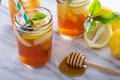 Homemade honey iced tea in mason jars with straws Stock Image