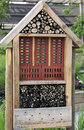 Homemade hotel for insects in the home garden from recycled material such as wood stone branches and twigs attracts beneficial Royalty Free Stock Image