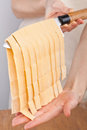Homemade italian parpadelle pasta fresh hanging from a knife Stock Image