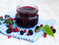 Homemade jam jar of on a wooden background Royalty Free Stock Images