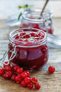 Homemade jam of red currants in a glass jar. Royalty Free Stock Photo