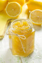 Homemade lemon jam in a glass jar and fresh fruits Stock Photography