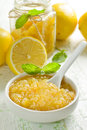 Homemade lemon jam in a glass jar and fresh fruits Royalty Free Stock Photos