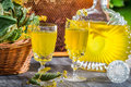Homemade liqueur made ​​of honey and dry lime leaves on old wooden table Royalty Free Stock Image
