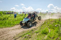 Homemade machine built with tuning rally buggy rides with the driver and co-driver at high speed past the spectators along the du Royalty Free Stock Photo