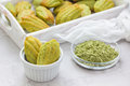 Homemade matcha green tea madeleines on the table and in wooden tray Royalty Free Stock Photo