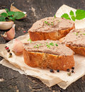Homemade meat snack chicken liver pate with savory and olives Stock Photography