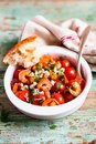 Homemade mediterranean meal with roasted cherry tomatoes, prawns or shrimps, fresh salted feta cheese, parsley served with freshly Royalty Free Stock Photo