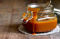 Homemade melted caramel in a glass jar Royalty Free Stock Image