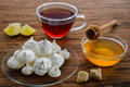 Homemade meringue tea and honey on a table Stock Images