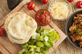 Homemade mexican flatbread taco with meat lettuce cheese and salsa Stock Images