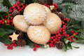 Homemade mince pies christmas pie cakes with holly mistletoe and snow covered fir Royalty Free Stock Photos