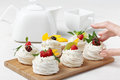 Homemade mini pavlova cakes with whipped cream and fresh berries Royalty Free Stock Photo