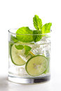 Homemade mojito cocktail with fresh limes, mint, and ice Royalty Free Stock Photo
