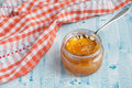 Homemade Orange jam with a spoon Royalty Free Stock Photography